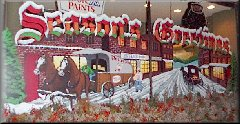 Season's Greetings painting on a Colony St business window