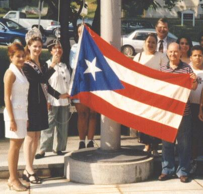 [Amy raises flag of Puerto Rico]
